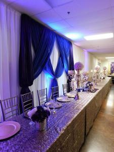 A beautiful wedding reception bridal party setup at Xclusive Events wedding venue in sunset louisiana