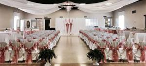 An indoor wedding reception setup by Fleur de Lis wedding coordinator and decorator located near Lafayette, Louisiana.