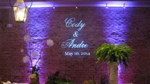 A wedding venue located near Lafayette, Louisiana with the names of the bride and groom on the wall, provided by Digital Music Services.