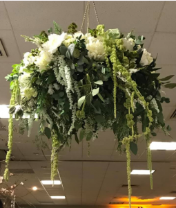 A hanging floral basket made for a wedding reception by, Posies by Paulie, located near Lafayette, Louisiana.