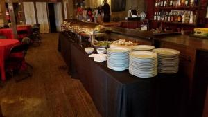 The buffet tables set up at the rustic barn wedding venue, Feed N Seed, located in Lafayette, Louisiana.