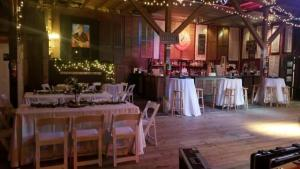 The rustic barn wedding venue located in Louisiana, Feed N Seed, setup for a Cajun wedding reception.