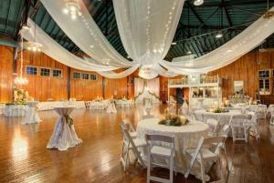 A beautiful photo of a wedding reception setup with curtains hanging from the ceiling at The Madison, located near Lafayette, LA.