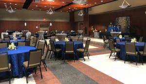 A wedding setup with blue linen at UL Lafayette Event Spaces.