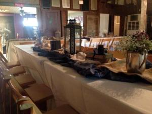 The catering tables set up for a wedding reception at the Louisiana rustic wedding venue, Feed N Seed, located in Lafayette, Louisiana.