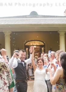 A couple leaving their reception with the guests using bubbles at this elegeant, beautiful wedding venue Louisiana Cajun Mansion located near Lafayette, Louisiana.
