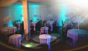 An event setup with tables and chairs at the beautiful wedding venue located near Lafayette, Louisiana, Xclusive Events.