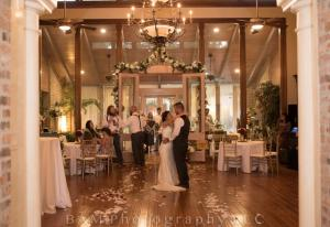 A bride and groom dancing their first dance at the wedding venue Louisiana Cajun Mansion located in Youngsville, Louisiana.