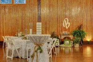 A wedding reception setup with tables and chairs at the wedding venue, The Madison, located near Lafayette, LA.