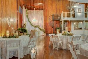A wedding reception setup showing tables and chairs and the bride and groom cake area at The Madison, located near Lafayette, Louisiana.