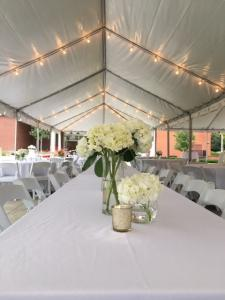 A wedding reception setup outdoor under a tent at UL Lafayette Event Spaces located in Lafayette, Louisiana.