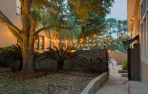 A nightime photo showing the courtyard at the wedding venue located near Lafayette, The Madison.