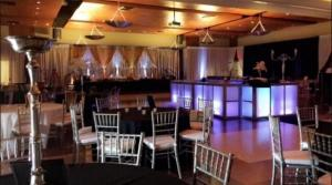 An indoor wedding reception setup with silver tables at UL Lafayette Event Spaces located in Lafayette, Louisiana.