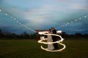 A bride and groom outdoor at the Warehouse 535, a wedding venue located in Lafayette, Louisiana.