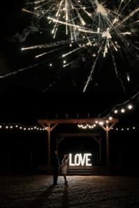 A bride and groom outdoor at the wedding venue, Warehouse 535, located in Lafayette, Louisiana.