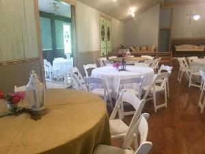 A wedding reception setup at the wedding venue located near Lafayette, Louisiana, Woodlawn Chapel.