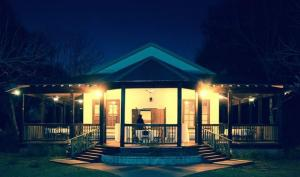 A beautiful night view of the front of the wedding venue, Woodlawn Chapel, located near Lafayette, Louisiana.
