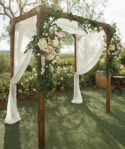 A photo of a decorated arbor at the wedding venue, Woodlawn Chapel, located near Lafayette, Louisiana.